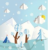 Vector illustration that looks like a colored paper pop up. Winter, clouds, snowflakes, snow peaks, trees, ski run and tourist's tent.