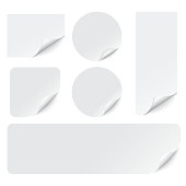 Paper stickers with curled corners on white background. Realistic paper adhesive sticker set. Sticky label banner mockup. Vector