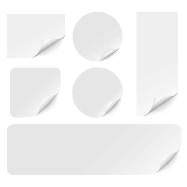 paper stickers with curled corners on white background. vector - naklejka stock illustrations