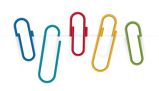 Colorful metal paperclips isolated on white.