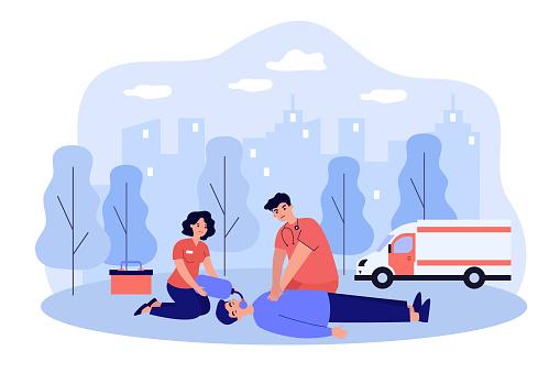 Paramedics resuscitating unconscious person