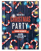 Christmas lights and candy canes on wood party invitation. The sparkling lights frame the outside. There is a border of candy canes and room for text in the center. Several layers for easy editing. Great for Christmas dinner, office parties, or an event poster.