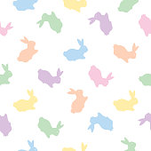 Vector seamless pattern of cute pastel rabbits.