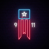 istock Patriot Day 9-11 neon sign. Twin Towers on american flag. Bright signboard September 11, 2001. Vector bright signboard. 1166188607