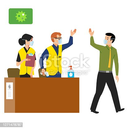 Man in face mask walking past 2 health and safety marshals standing behind a check in desk