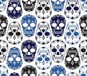 Pattern of blue, black and white skulls