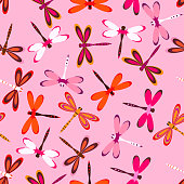 seamless pattern with colorful dragonflies on pink, bright background with multicolor dragonflies
