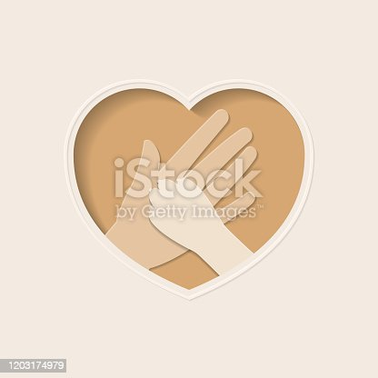 istock Paw of dog and hand in heart shaped paper art 1203174979