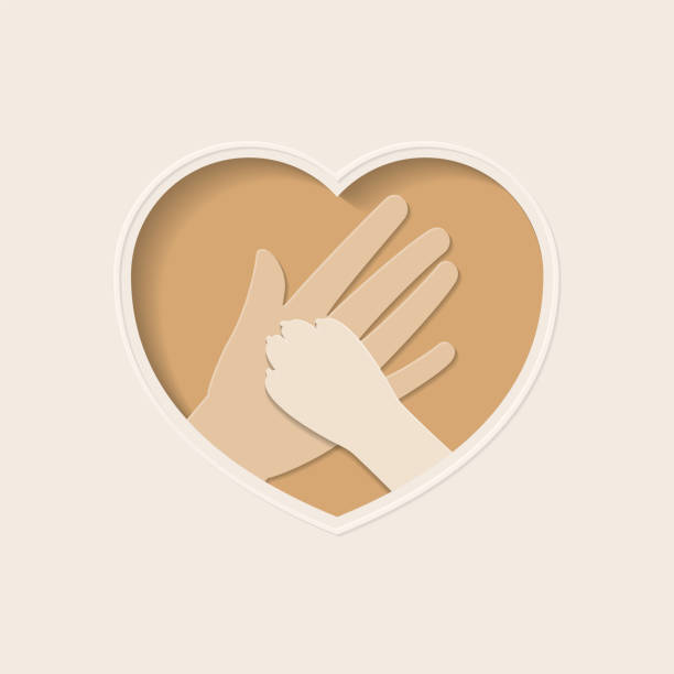 Paw of dog and hand in heart shaped paper art Big hand of human holding paw of dog, in brown heart shaped frame paper art greeting card animal shelter stock illustrations