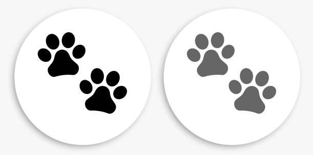 Paw Prints Black and White Round Icon vector art illustration