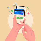 istock Pay by credit card via electronic wallet wirelessly on phone. New mobile banking app and e-payment vector illustration. Hand with smartphone  online banking. Shopping by phone and connected card. 1191967417