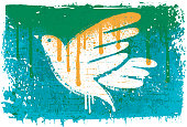Vector image background of a dove stencil over a rough painted wall with smears, and splatters. Rough and cracked paint on grunge background.