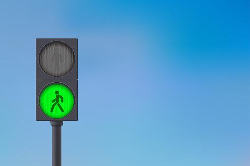 Pedestrian Traffic Light. Green light on. Sky background