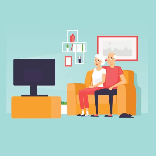 ilustraciones, imágenes clip art, dibujos animados e iconos de stock de jubilados se sientan en el sofá viendo la televisión. ilustración de vector de diseño plano. - geriatría