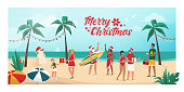People celebrating Christmas on summer in the southern hemisphere, they are partying on the beach and exchanging gifts