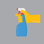 People Hand with Yellow Gloves Holding Cleaning Spray Bottle