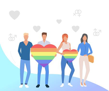 People holding rainbow hearts