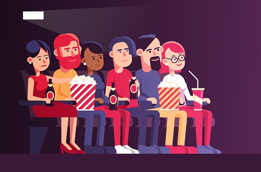People in cinema watching a movie