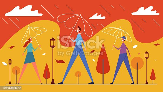 istock People in rain stand under umbrellas in city park 1323046072