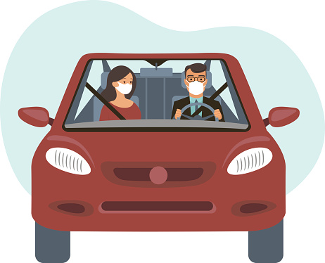 People inside the car wearing protective masks. Travel restrictions on coronavirus COVID-19 pandemic concept
