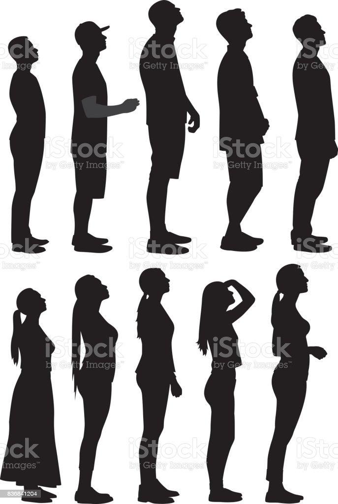 Nachschlagen von Silhouetten 2 Personen – Vektorgrafik
