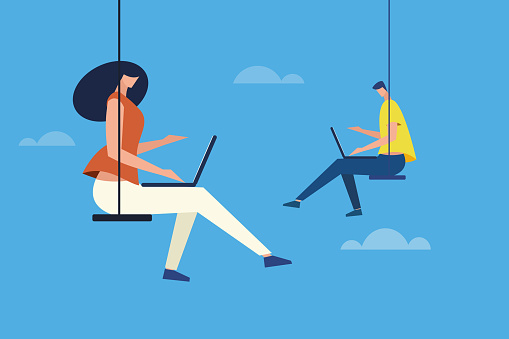 People sitting on a swing and working with laptop in an open sky. Concept for cloud computing