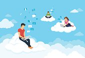 People sitting on the clouds in sky and using laptops