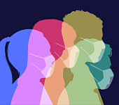 Colourful silhouettes of people wearing protective face masks against infection