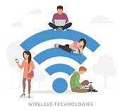 People with gadgets using wi-fi outdoors