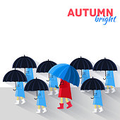 People with umbrella in a autumn raining day background concept.