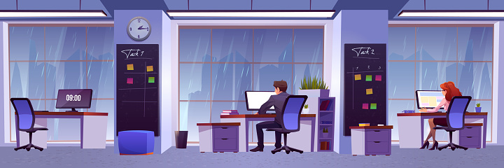 People work in office with rain outside window
