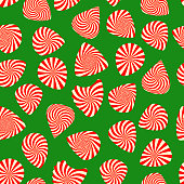 Peppermint candy finish guitar pick seamless pattern on green background. Concept for Christmas holiday wrapping paper with mint color pick silhouettes. Vector illustration