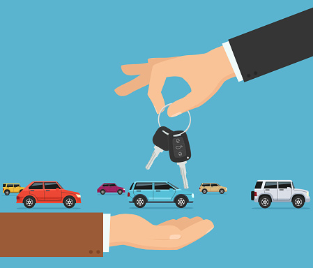Person gives apartment keys to another person. Concept transfer automobile keys.