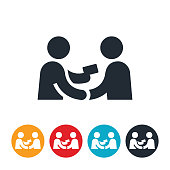 An icon of a person handing another person a business card. The icon represents networking or handing out a business card to a prospective employer.