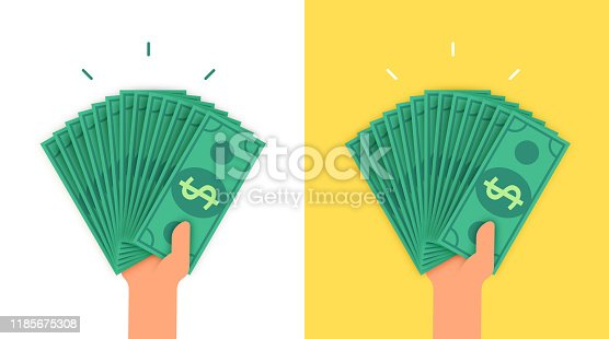 A human hand holding a large amount of cash money currency dollar bills. Rich wealth person concept.