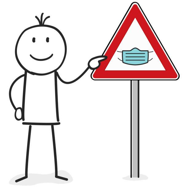 person zeigen auf einem tragen schutz gesichtsmaske zeichen - ffp2 maske stock-grafiken, -clipart, -cartoons und -symbole