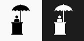 Person Sitting Under Umbrella Icon on Black and White Vector Backgrounds. This vector illustration includes two variations of the icon one in black on a light background on the left and another version in white on a dark background positioned on the right. The vector icon is simple yet elegant and can be used in a variety of ways including website or mobile application icon. This royalty free image is 100% vector based and all design elements can be scaled to any size.