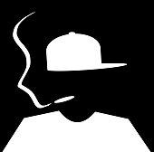 silhouette of person smoking marijuana