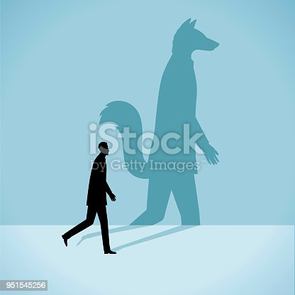 The silhouette of a man who has the the shadow of a fox