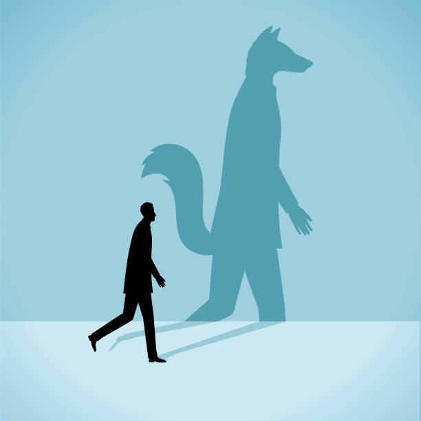 Personality Illustration The silhouette of a man who has the the shadow of a fox dishonesty stock illustrations