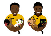 Man and woman holding dogs and cats