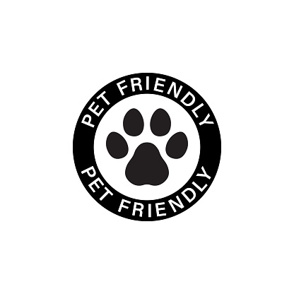 Pet paw or dog label. Footprint with pet friendly text. Vector on isolated white background. EPS 10