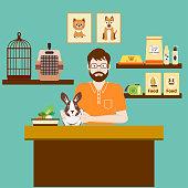 Pet shops seller with cute rabbit. Accessories for animals care, food, etc.  Pet shop concept.