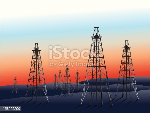 Paesaggio cupo con pozzi di petrolio