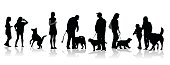 Silhouette vector illustration of a large group of people and their pet dogs of various breeds