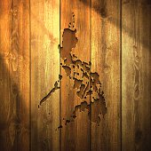 Philippines Map on lit Wooden Background