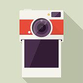 istock Photo Camera with Empty polaroid photo frame 1035204890