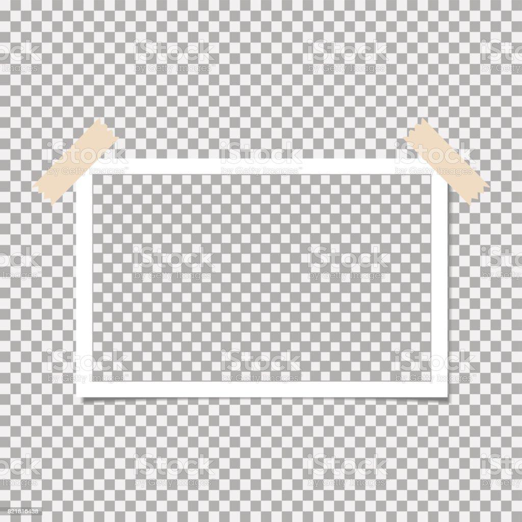 灰色の背景に粘着テープ付きフォト フレームあなたのトレンディな写真の