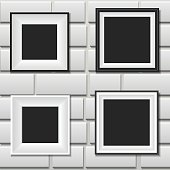 Photo frames on the white wall
