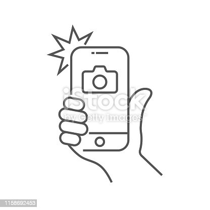 istock Photo on smartphone with flash, hand is holding smartphone and doing photo. Camera viewfinder, hand and flash. Editable Stroke. EPS 10. 1158692453